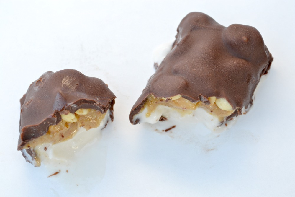 Layered with nondairy ice cream, raw caramel, peanuts, and dipped into melted chocolate, these Vegan Ice Cream Snickers Bars are the perfect cool treat.